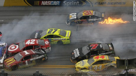Flames trail from the car of Ryan Newman (31) after a pile up of crashed cars round the track during the NASCAR Talladega auto race at Talladega Superspeedway, Sunday, May 1, 2016, in Talladega, Ala. (AP Photo/Skip Williams)
