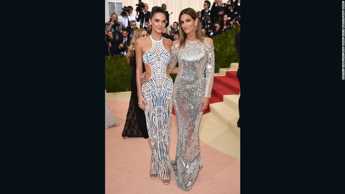 Kendall Jenner wears Versace, and is pictured here with model Cindy Crawford, who is dressed in Balmain.