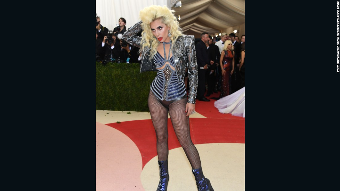 Lady Gaga takes on the red carpet in this Versace ensemble.