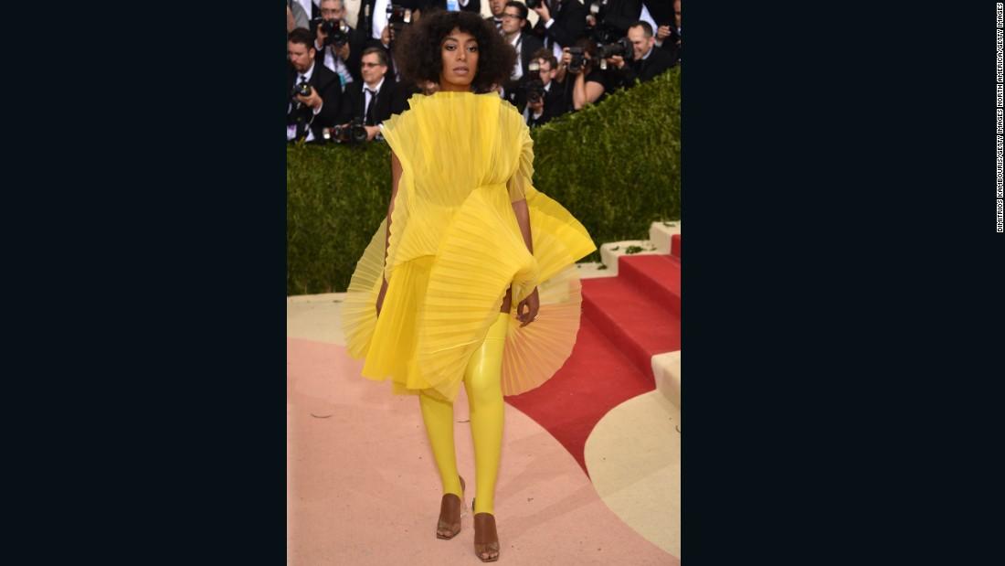 Solange Knowles wears a lemon yellow ensemble by David LaPort.