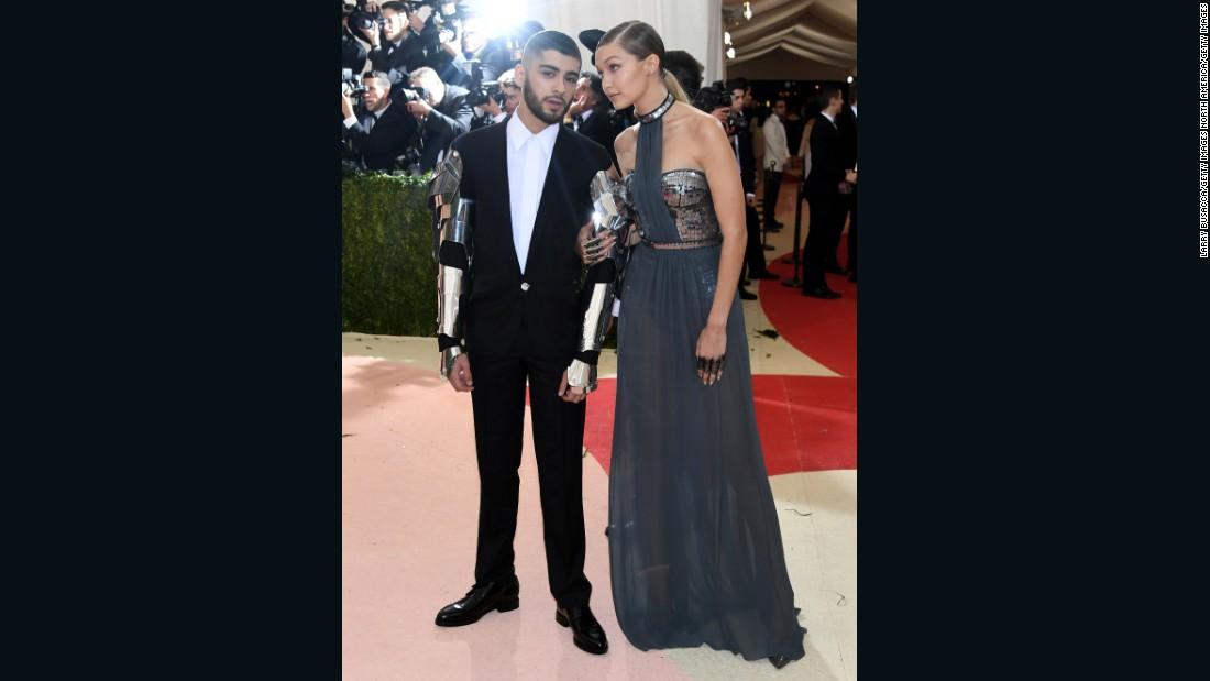 Model Gigi Hadid is pictured alongside singer Zayn Malik, and wears Tommy Hilfiger.