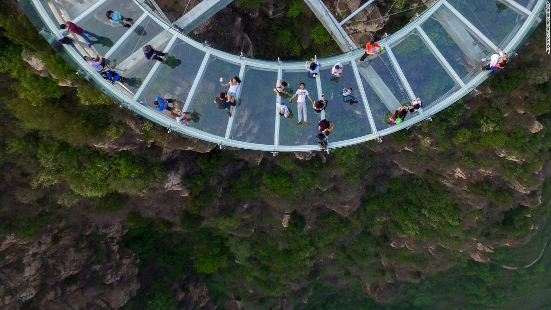 A 33-meter-long glass viewing platform opened in Beijing's Shilinxia Scenic Area on April 30. It overlooks a 1,300-foot-deep valley.