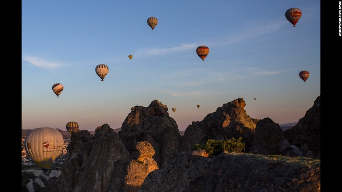 Hot-air ballooning is a popular tourist activity in Cappadocia, a UNESCO World Heritage Site in Central Anatolia. The area is characterized by a distinctive volcanic landscape and large network of ancient underground dwellings.