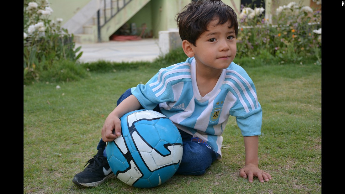 Lionel messi playing soccer as a kid
