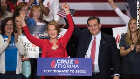 Republican presidential candidate Sen. Ted Cruz holds up hands with former Hewlett-Packard chief executive Carly Fiorina, at a campaign rally in the Pavilion at the Pan Am Plaza on April 27, 2016 in Indianapolis. Cruz named Carly Fiorina as his pick for vice president running mate during the rally.