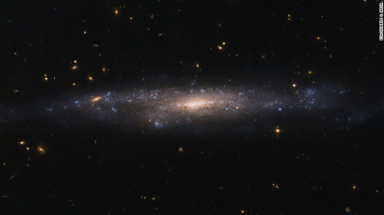 The Hubble Space Telescope captured an image of a hidden galaxy that is fainter than Andromeda or the Milky Way. This low surface brightness galaxy, called UGC 477, is located over 110 million light-years away in the constellation of Pisces.