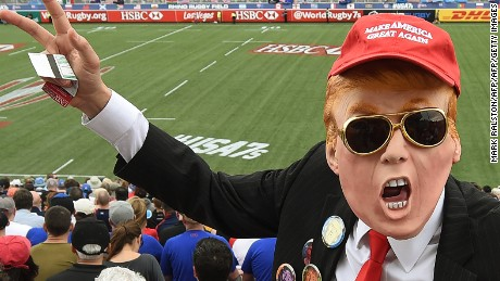 A fan dressed as US Republican presidential hopeful Donald Trump poses in the crowd during day two of the Men's 2016 USA Sevens Rugby Tournament match at the Sam Boyd Stadium in Las Vegas, Nevada on March 5, 2016. / AFP / MARK RALSTON        (Photo credit should read MARK RALSTON/AFP/Getty Images)