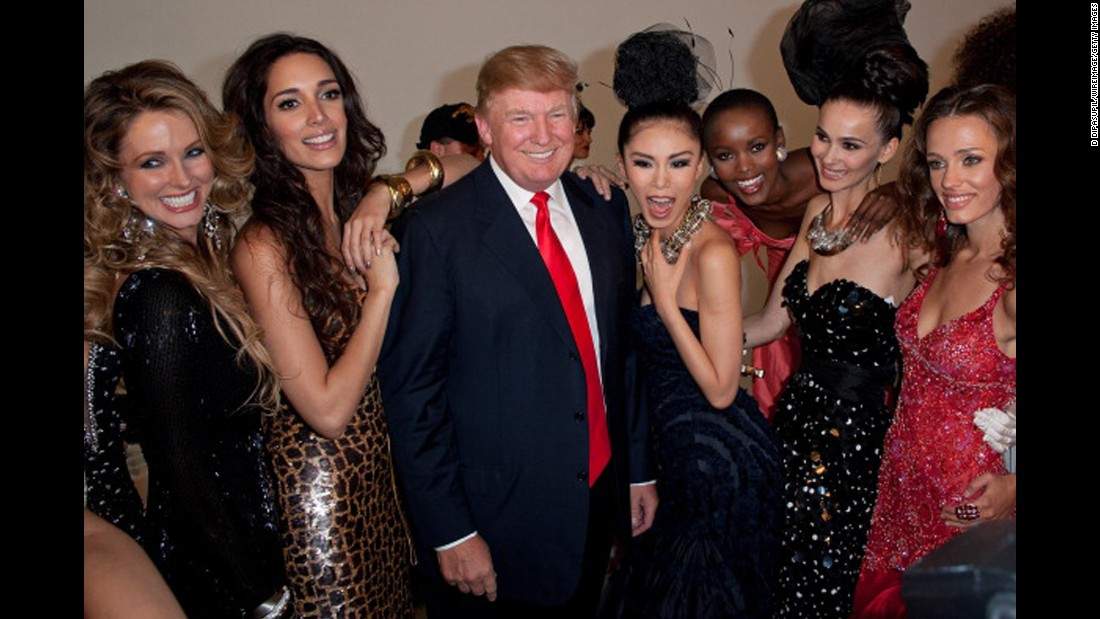 Trump poses with Miss Universe contestants in 2011. Trump has been executive producer of the Miss Universe, Miss USA and Miss Teen USA pageants since 1996.