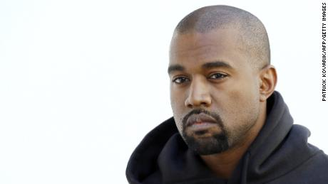 American rapper Kanye West poses before Christian Dior 2015-2016 fall/winter ready-to-wear collection fashion show on March 6, 2015 in Paris. AFP PHOTO / PATRICK KOVARIK        (Photo credit should read PATRICK KOVARIK/AFP/Getty Images)