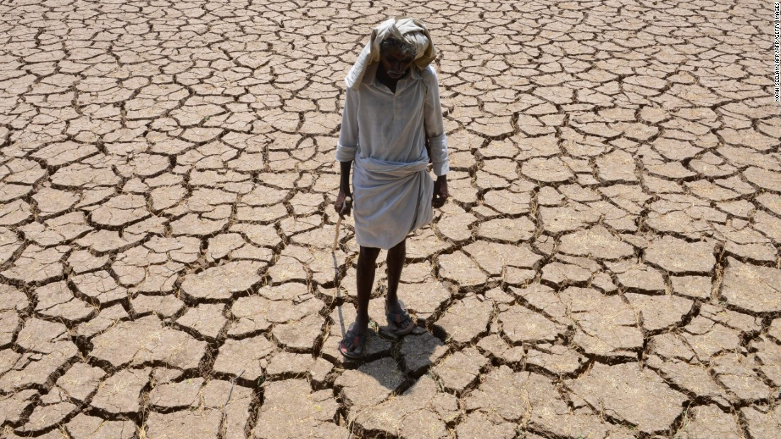 A farmer poses in his dried-up cotton field in Nalgonda, India, on Monday, April 25.