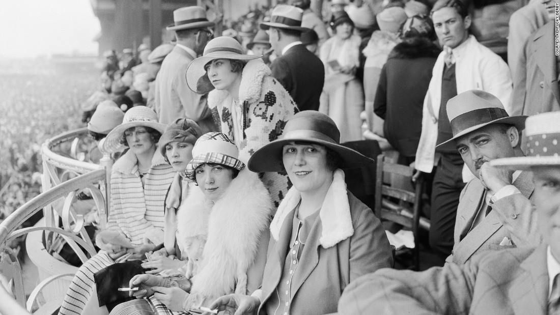 "The Derby first launched in 1875, and up until the turn of the 20th century women could be seen wearing hats, gloves, and long dresses down to their ankles.<br />""At any social outing in America at that time, you would have worn a hat and gloves -- and the Kentucky Derby was no different,"" said Chris Goodlet, Curator of Collections at the <a href=""http://www.derbymuseum.org/"" target=""_blank"">Kentucky Derby Museum.</a><br />""Many women would have worn silk because of the warm weather, and be carrying a parasol.""<br />This image features race-goers in 1926."