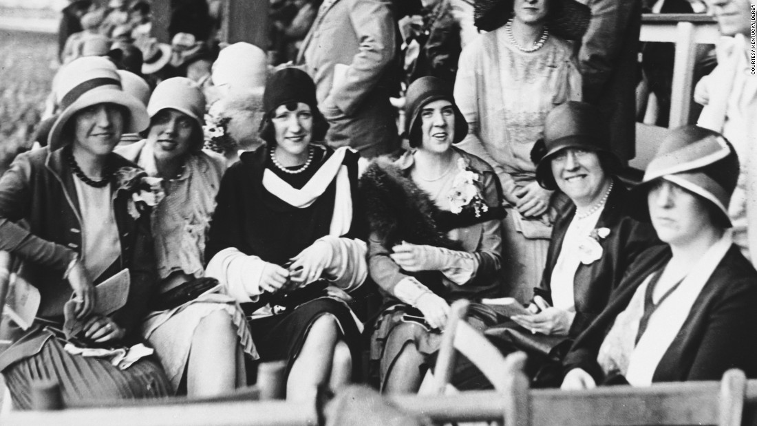 In the 1920s, women would also been seen wearing tailored suits. Hats and gloves were still in vogue.