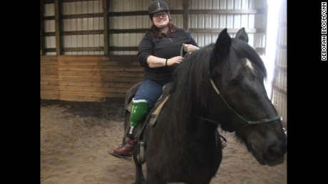 After devastating accident, woman gets back in the saddle