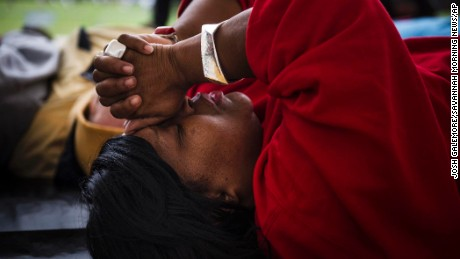 "Linda Wilder Bryan who lost her son Lawrence in a shooting last August prays during the ""Die in, Lay in"" Saturday, Jan. 9, 2016, in memory of those murdered in Savannah, Ga., during 2015. (Josh Galemore/Savannah Morning News via AP) THE EXAMINER.COM OUT; SFEXAMINER.COM OUT; WASHINGTONEXAMINER.COM OUT; MANDATORY CREDIT"