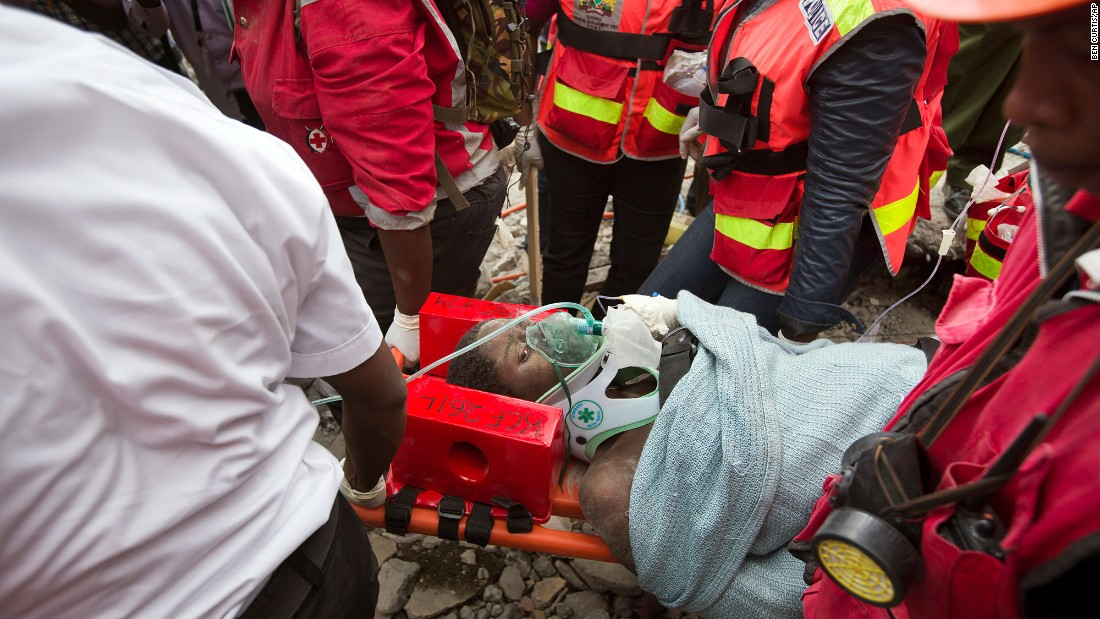 "Medics carry a woman on Thursday, May 5, after she was pulled from the rubble of a collapsed building in Nairobi, Kenya. She was trapped in the rubble for six days. Click through for more amazing stories of survival, including the saga of Chilean miners, a man aboard the Costa Concordia and the ""miracle babies"" of the Mexico earthquake."