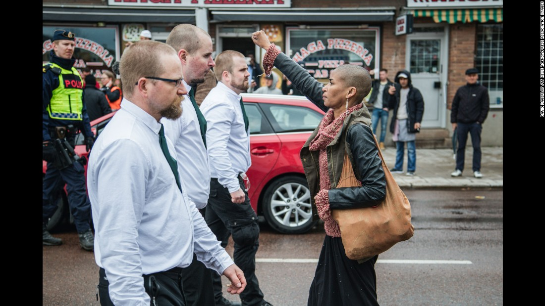 Tess Apslund, 42, stands with a raised fist in front of uniformed neo-Nazis during a Nordic Resistance Movement demonstration in Borlange, Sweden, on Sunday, May 1. Click through the gallery to see memorable images from other protests throughout history.
