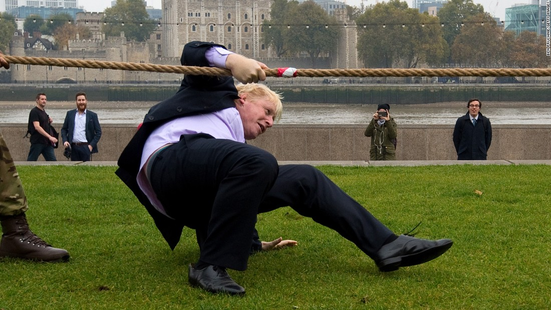 Johnson falls while competing in a tug of war October 27, 2015, during the launch of London Poppy Day.