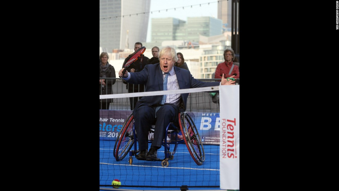 Johnson plays wheelchair tennis to promote a tournament in London on November 24, 2014.