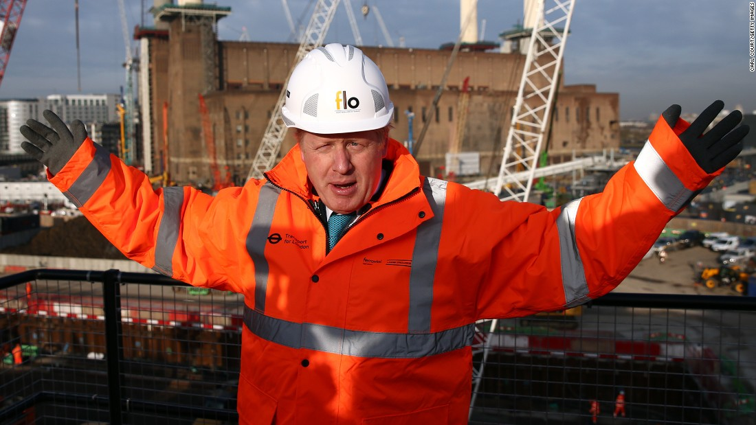 Johnson poses for a photograph to mark the start of a London Underground extension on November 23, 2015.