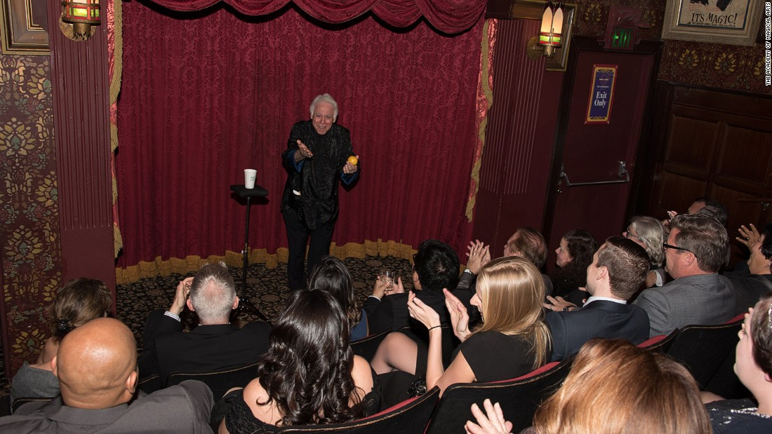 Magician Stan Gerson entertains the crowd in the Parlour of Prestidigitation, one of several theaters spread throughout the building.