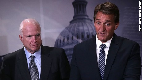 Sen. John McCain (R-AZ) (L) and Sen. Jeff Flake (R-AZ) (R) speak to members of the media during a news conference November 4, 2015 on Capitol Hill in Washington, DC.
