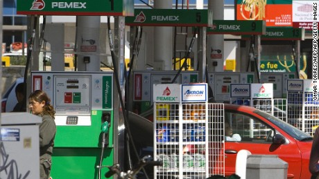 A car waits in between a line of gas pumps at a Pemex (Mexican Petroleoum) gasoline station in Mexico City, 09 January 2008. The increase in the prices of basic products along with the controversy for the liberalization of the agrarian chapter of the North American Free Trade Agreement (NAFTA), and the violence due to drug trafficking, are giving a complicated beginning of the year to the Mexican government. The rises, predicted by the leftist opposition, are a result of the approval of a fiscal reform last year which takes effect in 2008. AFP PHOTO/ Omar TORRES (Photo credit should read OMAR TORRES/AFP/Getty Images)