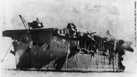 1st July 1946:  The remains of the light carrier the USS Independence, burning but still afloat, following America's atomic bomb test in Bikini Lagoon.  (Photo by Keystone/Getty Images)