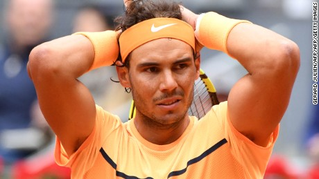 Spanish tennis player Rafael Nadal gestures after losing a point against Britain tennis player Andy Murray during the men semifinal of Madrid Open tournament at the Caja Magica (Magic Box) sports complex in Madrid on May 7, 2016. / AFP / GERARD JULIEN        (Photo credit should read GERARD JULIEN/AFP/Getty Images)