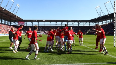 INGOLSTADT, GERMANY - MAY 07:  Bayern Muenchen players celebrate the Bundesliga champions after beating Ingolstadt 2-1 in the Bundesliga match between FC Ingolstadt and FC Bayern Muenchen at Audi Sportpark on May 7, 2016 in Ingolstadt, Germany.  (Photo by Alex Grimm/Bongarts/Getty Images)