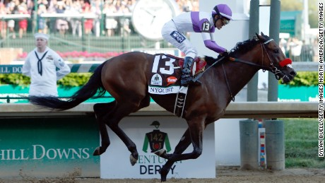 LOUISVILLE, KY - MAY 07:  Nyquist #13, ridden by Mario Gutierrez, crosses the finish line to win the 142nd running of the Kentucky Derby at Churchill Downs on May 07, 2016 in Louisville, Kentucky.  (Photo by Dylan Buell/Getty Images)
