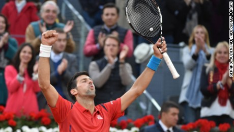 Serbia's Novak Djokovic celebrates beating Britian's Andy Murray during the Madrid Open men's tennis final at the Caja Magica (Magic Box) sports complex in Madrid on May 8, 2016. / AFP / GERARD JULIEN        (Photo credit should read GERARD JULIEN/AFP/Getty Images)