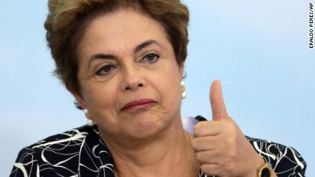 """Brazil's President Dilma Rousseff gives a thumbs up during a ceremony announcing an addition to the government subsidized housing program coined """"My home, My life, at Planalto presidential palace in Brasilia, Brazil, Friday, May 6, 2016. Brazil's Senate impeachment commission has started deliberations over whether to recommend the suspension of Rousseff to the full house. A Friday vote by a simple majority will send the case to all senators for a final decision Wednesday."""