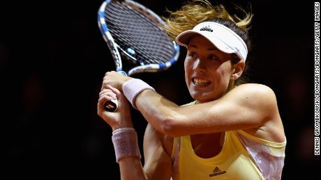 STUTTGART, GERMANY - APRIL 22:  Garbine Muguruza of Spain plays a backhand in her match against Petra Kvitova of Czech Republic during Day 5 of the Porsche Tennis Grand Prix at Porsche-Arena on April 22, 2016 in Stuttgart, Germany.  (Photo by Dennis Grombkowski/Bongarts/Getty Images)