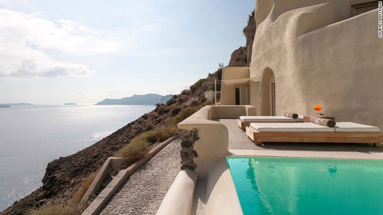 Pool with a panorama: Santorini's Mystique.