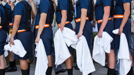 Incoming Citadel freshman known as knobs stand in formation as they read from the Guidon while waiting to be issued a uniform at The Citadel, The Military College of South Carolina