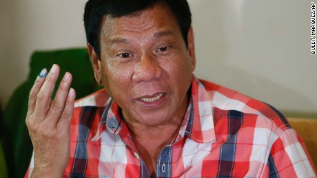 Front-running presidential candidate Mayor Rodrigo Duterte gestures during his second news conference after voting in a polling precinct at Daniel R. Aguinaldo National High School, Matina district, his hometown in Davao city in southern Philippines Monday, May 9, 2016. Duterte was leading by a wide margin in unofficial tallies but still refuses to claim victory. (AP Photo/Bullit Marquez)