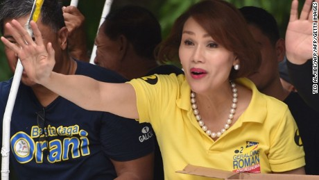 This photo taken on April 30, 2016 shows legislator candidate Geraldine Roman waving to supporters during a campaign trip to the town of Hermosa, Bataan province, north of Manila. The 49-year-old Roman, a member of a powerful political family, is a strong chance to win a seat in the nation's lower house in the May 9 election, in what would be a remarkable breakthrough for the lesbian, gay, bisexual and transgender (LGBT) community. / AFP / TED ALJIBE / TO GO WITH AFP STORY BY Ayee Macaraig        (Photo credit should read TED ALJIBE/AFP/Getty Images)
