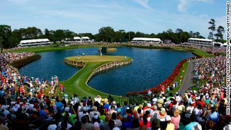 PONTE VEDRA BEACH, FL - MAY 12: A gallery of fans watch as Rickie Fowler of the United States putts on the 17th green during the third round of THE PLAYERS Championship held at THE PLAYERS Stadium course at TPC Sawgrass on May 12, 2012 in Ponte Vedra Beach, Florida.  (Photo by Mike Ehrmann/Getty Images)