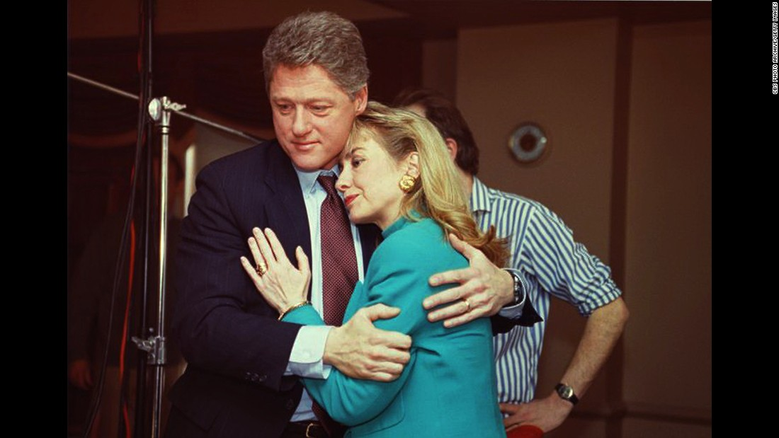 "Bill Clinton comforts his wife on the set of ""60 Minutes"" after a stage light broke loose from the ceiling and knocked her down in January 1992."