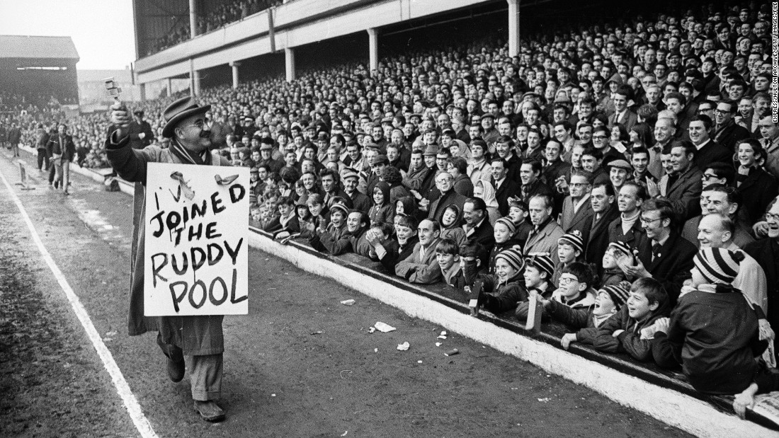 """Warren Mitchell, who played a bigoted cockney West Ham supporter in the TV series """"Till Death Us Do Part,"""" is pictured at Upton Park in February 1968."""