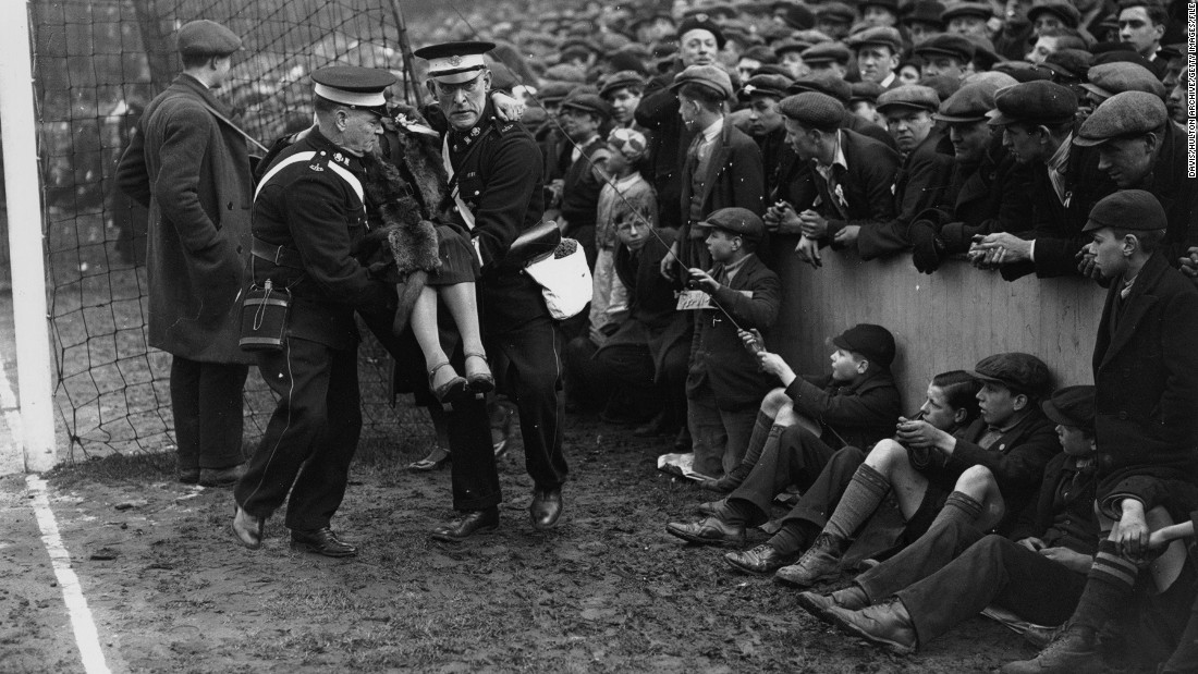 An injured spectator is removed from the crowd during a sixth-round FA Cup clash between West Ham United and Birmingham City at Upton Park in March 1933.