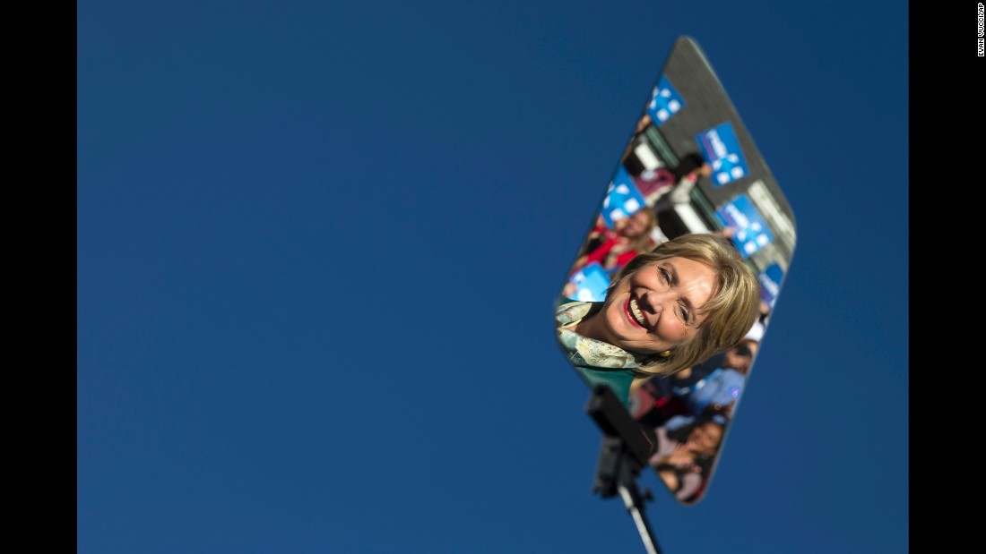 Clinton is reflected in a teleprompter during a campaign rally in Alexandria, Virginia, in October 2015.