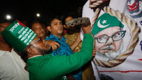 A Bangladeshi man throws a shoe at a Motiur Rahman Nizami poster to celebrate the execution of the Jamaat-e-Islami party's senior leader outside Dhaka's central jail, Bangladesh, early Wednesday, May 11, 2016. Nizami is the fifth man to be hanged as three other senior colleagues from his Islamist party and another senior leader of main opposition Bangladesh Nationalist Party led by former Prime Minister Khaleda Zia have been hanged since 2013. (AP Photo)