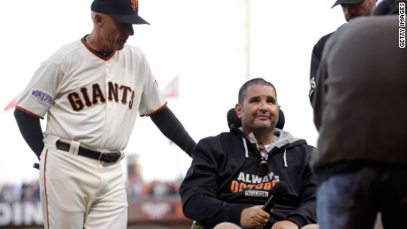 SAN FRANCISCO, CA - OCTOBER 25: San Francisco  Giants fan Bryan Stow with Tim Flannery #1 of the San Francisco Giants before Stow yells Play Ball! before Game Four of the 2014 World Series at AT&T Park on October 25, 2014 in San Francisco, California.  (Photo by Ezra Shaw/Getty Images)