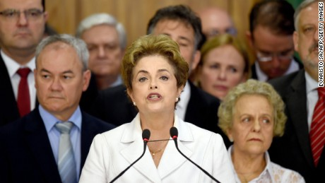 Brazil's suspended President Dilma Rousseff makes a statement next to her mother Dilma Jane Coimbra(R) at the Planalto Palace in Brasilia on May 12, 2016. Rousseff said Thursday that democracy and the constitution are at stake after she was forced to face an impeachment trial in the Senate and cede power to vice president Michel Temer.