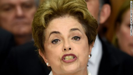 Brazil's suspended President Dilma Rousseff makes a statement at the Planalto Palace in Brasilia on May 12, 2016. Rousseff said Thursday that democracy and the constitution are at stake after she was forced to face an impeachment trial in the Senate and cede power to vice president Michel Temer.