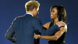 Britan's Prince Harry, left, greets First Lady Michelle Obama on stage during the opening ceremony for the Invictus Games, Sunday, May 8, 2016, in Kissimmee, Fla. (AP Photo/John Raoux)