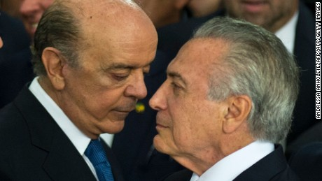 """Brazilian acting president Michel Temer (R) speaks with the new Foreign Minister Jose Serra, during the new ministers' inauguration ceremony at Planalto palace in Brasilia, on May 12, 2016.  Temer said Thursday his new cabinet must work to restore the country's """"credibility,"""" in his first address after assuming power from suspended predecessor Dilma Rousseff pending her impeachment trial. / AFP / ANDRESSA ANHOLETE        (Photo credit should read ANDRESSA ANHOLETE/AFP/Getty Images)"""