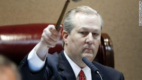 FILE - In this Feb. 2, 2016 file photo, Rep. Mike Hubbard of Auburn, Ala., pounds the gavel to signify the beginning of Alabama legislation's opening,  in Montgomery, Ala.  Hubbard awaits a trial on 23 felony ethics charges that could result in his removal.(AP Photo/Brynn Anderson)