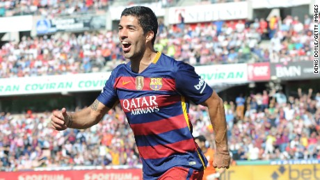Luis Suarez scored a hat-trick as Barcelona sealed the La La title at Granada.